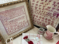 A Collection of Antique Red Samplers