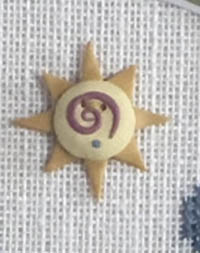Swirly Sun Button